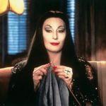 Can We Talk About…? Anjelica Huston's Iconically Campy Morticia Addams