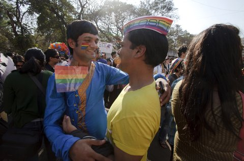 MUMBAI, INDIA - JANUARY 28:  Two men embrace each other during Queer Azaadi or gay and lesbian parade on January 28, 2012 in Mumbai, India . The annual march has been taking place in Mumbai since 2008 to fight discrimination against homosexuals. On July 2, 2009, The Delhi High Court in India passed a landmark judgement which allowed same sex acts in private between consenting adults. (Photo by Kuni Takahashi/Getty Images)