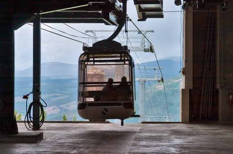 Gondola cars ready to leave from the top of Aspen Mountain. (Photo by: MyLoupe/UIG via Getty Images)