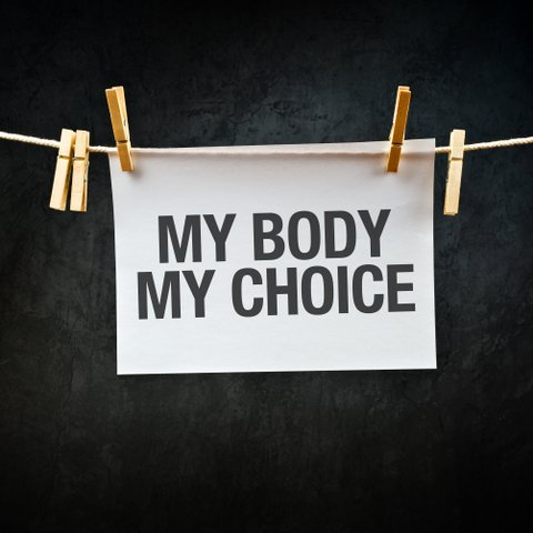My Body My Choice message printed on apper hanging on clothesline.