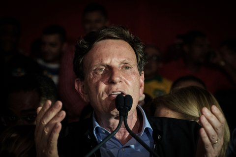 Rio de Janeiro's newly elected Mayor, Marcelo Crivella (L) of the Brazilian Republican Party (PRB) delivers a speech, after winning the municipal elections' second round with Marcelo Freixo of the Socialism and Freedom Party (PSOL) in Rio de Janeiro, Brazil, on October 30, 2016. This was the second round of balloting for city halls around Latin America's biggest country and confirmed the trend seen in October 2 polls which ended in humiliation for the former governing Workers' Party. / AFP / YASUYOSHI CHIBA        (Photo credit should read YASUYOSHI CHIBA/AFP/Getty Images)