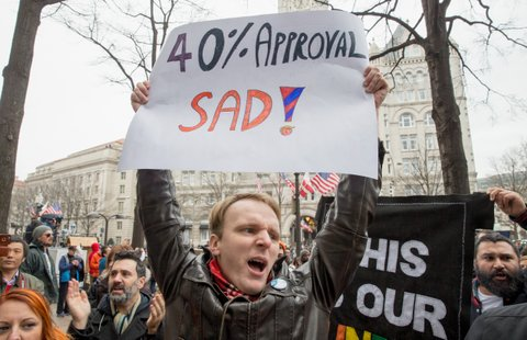 WASHINGTON, DC - JANUARY 20:  Protesters against and supporters of Donald Trump gather prior to the presidential inauguration in front of the Trump Hotel on January 20, 2017 in Washington, DC. Donald Trump is being sworn in as the 45th President of the United States.  (Photo by Tasos Katopodis/Getty Images)