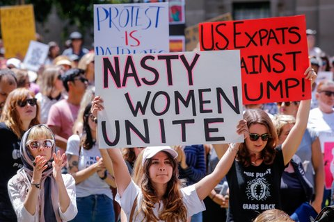 MELBOURNE, AUSTRALIA - JANUARY 21:  Protesters take part in the Melbourne rally to protest against the Trump Inauguration on January 21, 2017 in Melbourne, Australia. The marches in Australia were organised to show solidarity with those marching on Washington DC and around the world in defense of women's rights and human rights.  (Photo by Wayne Taylor/Getty Images)