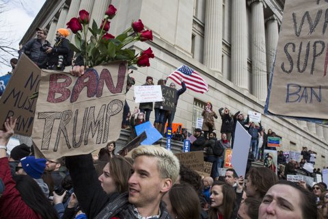 WASHINGTON, DC - JANUARY 29: Demonstrators gather near The White House to protest President Donald Trump's travel ban on seven Muslim countries on January 29, 2017 in Washington, DC. President Trump signed the controversial executive order that halted refugees and residents from predominantly Muslim countries from entering the United States. (Photo by Zach Gibson/Getty Images)