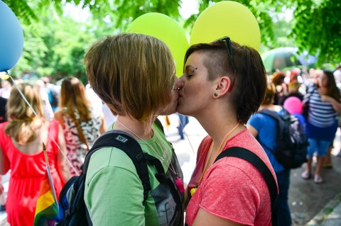 Two women kiss as they attend the Gay Pride Parade in Ljubljana, Slovenia, on June 15, 2013. AFP PHOTO / JURE MAKOVEC        (Photo credit should read Jure Makovec/AFP/Getty Images)