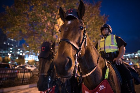 CLEVELAND, OH - NOVEMBER 02: Cleveland Mounted Police keep watch near Progressive Field before the start of game 7 of the World Series between the Cleveland Indians and the Chicago Cubs on November 2, 2016 in Cleveland, Ohio. This marks the 37th Game 7 in World Series history. (Photo by Justin Merriman/Getty Images)