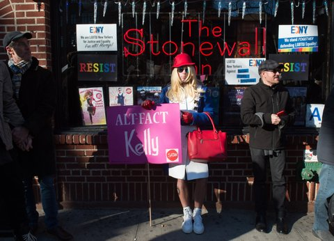 People protest in front of the Stonewall Inn in solidarity with immigrants, asylum seekers, refugees, and the LGBT community on February 4, 2017 in New York.  The demonstrators protested the policies of US President Donald Trump. / AFP / 20202243A / Bryan R. Smith        (Photo credit should read BRYAN R. SMITH/AFP/Getty Images)