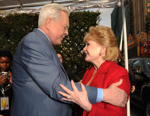 HOLLYWOOD, CA - APRIL 12:  TCM host Robert Osborne (L) and actress Debbie Reynolds arrive at the 2012 TCM Classic Film Festival Opening Night Gala held at Grauman's Chinese Theatre on April 12, 2012 in Hollywood, California. (Photo by Jason Merritt/WireImage) 22307_009_ JM_0095.JPG