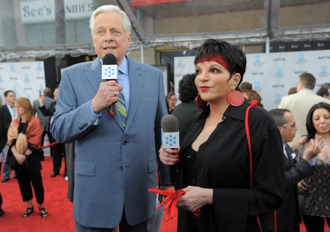 HOLLYWOOD, CA - APRIL 12:  TCM Host Robert Osborne (L) and singer/actress Liza Minnelli arrive at the 2012 TCM Classic Film Festival Opening Night Gala held at Grauman's Chinese Theatre on April 12, 2012 in Hollywood, California. (Photo by Jordan Strauss/WireImage) 22307_008_JS_0363.JPG