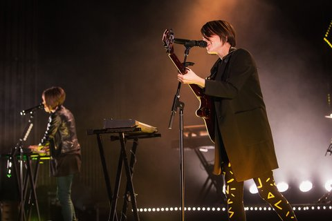 SEATTLE, WA - NOVEMBER 11:  Tegan Quin (L) and Sara Quin of Tegan and Sara perform on stage at the Paramount Theatre on November 11, 2014 in Seattle, Washington.  (Photo by Mat Hayward/Getty Images)