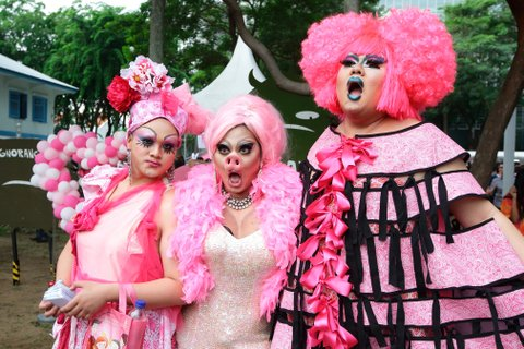 SINGAPORE - JUNE 13:  Participants dress in various shades of pink pose for a photo during the ?Pink Dot SG? event at Hong Lim Park on June 13, 2015 in Singapore. Pink Dot SG is Singapore's annual rally to support the Freedom to Love regardless of sexual orientation or gender identity, entering its seventh consecutive year at Hong Lim Park with this year's Ambassadors, Corporate Sponsors, 2015 Campaign Video, and a fresh line-up for the Pink Dot Concert. Singapore has been shrouded in controversy over its approach to same sex relationships with an all out ban on same sex relationships between men.  (Photo by Suhaimi Abdullah/Getty Images)