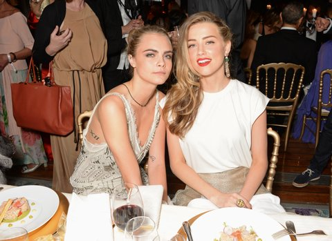 CAP D'ANTIBES, FRANCE - MAY 20:  Cara Delevingne (L) and Amber Heard attend the de Grisogono 'Fatale In Cannes' party during the 67th Cannes Film Festival at Hotel du Cap-Eden-Roc on May 20, 2014 in Cap d'Antibes, France.  (Photo by David M. Benett/Getty Images)