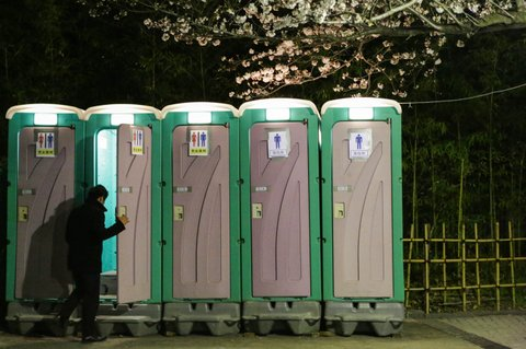 TOKYO, JAPAN - APRIL 01:  Public toilet set for the people coming for cherry blossoms at Asakusa on March 31, 2016 in Tokyo, Japan.  During cherry blossom season thousands of people gather across Japan to practice 'Hanami,' picnicking under a blooming Sakura tree to enjoy food and drinks. (Photoby Taro Karibe/Getty Images)
