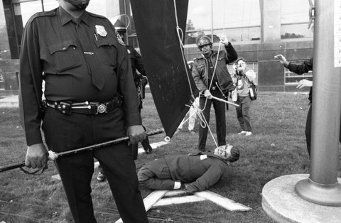 ROCKVILLE  - OCTOBER 11:   Protesters prepare to hang an effigy of Ronald Regan at a protest organized by AIDS activist group ACT UP (AIDS Coalition to Unleash Power) at the headquarters of the Food and Drug Administration (FDA) on October 11, 1988 in Rockville, Maryland.  The action, called SEIZE CONTROL OF THE FDA by the group, shut down the FDA for the day.  (Photo by Catherine McGann/Getty Images)