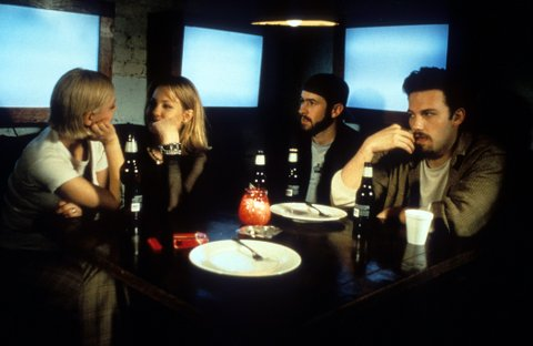 Ben Affleck, Jason Lee and Joey Lauren Adams sitting at a dining table in a scene from the film 'Chasing Amy', 1997. (Photo by View Askew Productions/Getty Images)