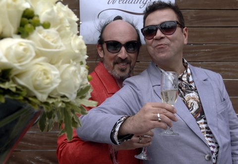 MONTEVIDEO, URUGUAY - AUGUST 22:  Sergio Miranda and Rodrigo Borda celebrate during his wedding as the first gay couple to get married in Uruguay on August 22, 2013 in Montevideo, Uruguay. Uruguay is the twelfth country in the world to allow same-sex marriage, and the second in Latin America after Argentina did back in 2010. (Photo by Dante Fernandez/LatinContent/Getty Images)