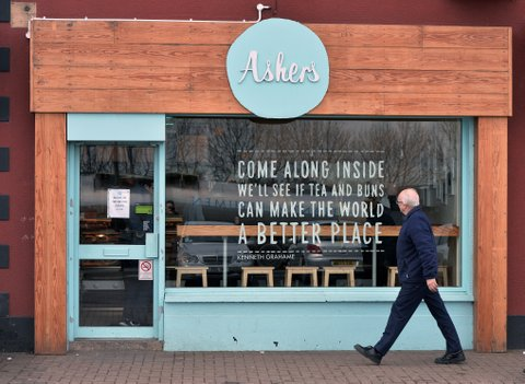 BELFAST, NORTHERN IRELAND - MARCH 26:   A customer of Asher's Bakery walks past one of their shops on March 26, 2015 in Belfast, Northern Ireland. Ashers, a Christian-run bakery triggered a discrimination row when it refused to bake a cake for the gay rights group Queerspace who had ordered the cake for an anti-homophobic event in May, 2014. The court action was brought by the Equality Commission for Northern Ireland, after the Newtownabbey-based business turned down an order for the cake bearing the slogan 'Support gay marriage'. The body claims Ashers' decision infringes on equality laws, and raises questions over when and how businesses can refuse service due to sexual orientation, religious belief or political opinion.  (Photo by Charles McQuillan/Getty Images).