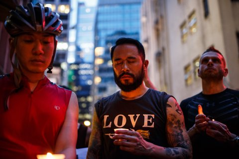 People hold candles as they share a minute of silence during a vigil for the victims of the Orlando shooting in Florida, in Hong Kong on June 13, 2016. Law enforcement authorities have lowered the death toll from the weekend massacre at a gay nightclub in Orlando to 49, the deadliest mass shooting in American history, explaining that the shooter had been counted in the original tally. / AFP / ANTHONY WALLACE        (Photo credit should read ANTHONY WALLACE/AFP/Getty Images)