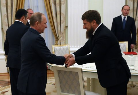 MOSCOW, RUSSIA - SEPTEMBER 23:  (RUSSIA OUT) Russian President Vladimir Putin (L) greets Head of Chechnya Ramzan Kadyrov (R) during his meeting with newly elected governors at the Kremlin on September, 23, 2016 in Moscow, Russia. Putin has received new governors who won their elections held last Sunday. (Photo by Mikhail Svetlov/Getty Images)