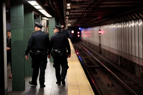 NEW YORK, NY - NOVEMBER 7: Members of the New York City Police patrol a subway station in Times Square, November 7, 2016 in New York City. With both presidential candidates holding their election night events in New York City, the NYPD has stepped up security ahead of election day. (Photo by Drew Angerer/Getty Images)