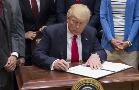 US President Donald Trump signs an executive order on Implementing an America-First Offshore Energy Strategy after signing it in the Roosevelt Room of the White House in Washington, DC, April 28, 2017. / AFP PHOTO / SAUL LOEB        (Photo credit should read SAUL LOEB/AFP/Getty Images)