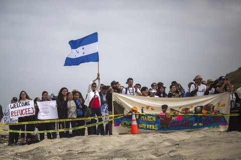 immigrants Honduran flag border crossing