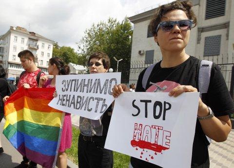 activists protest killed LGBTQ activist Russia