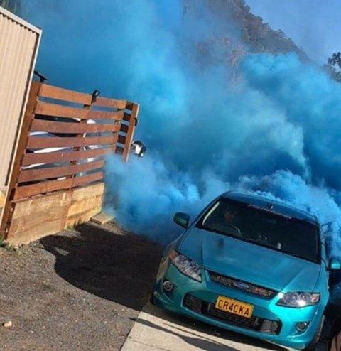 Car doing burnout gender reveal