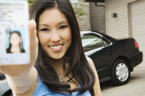 woman showing license