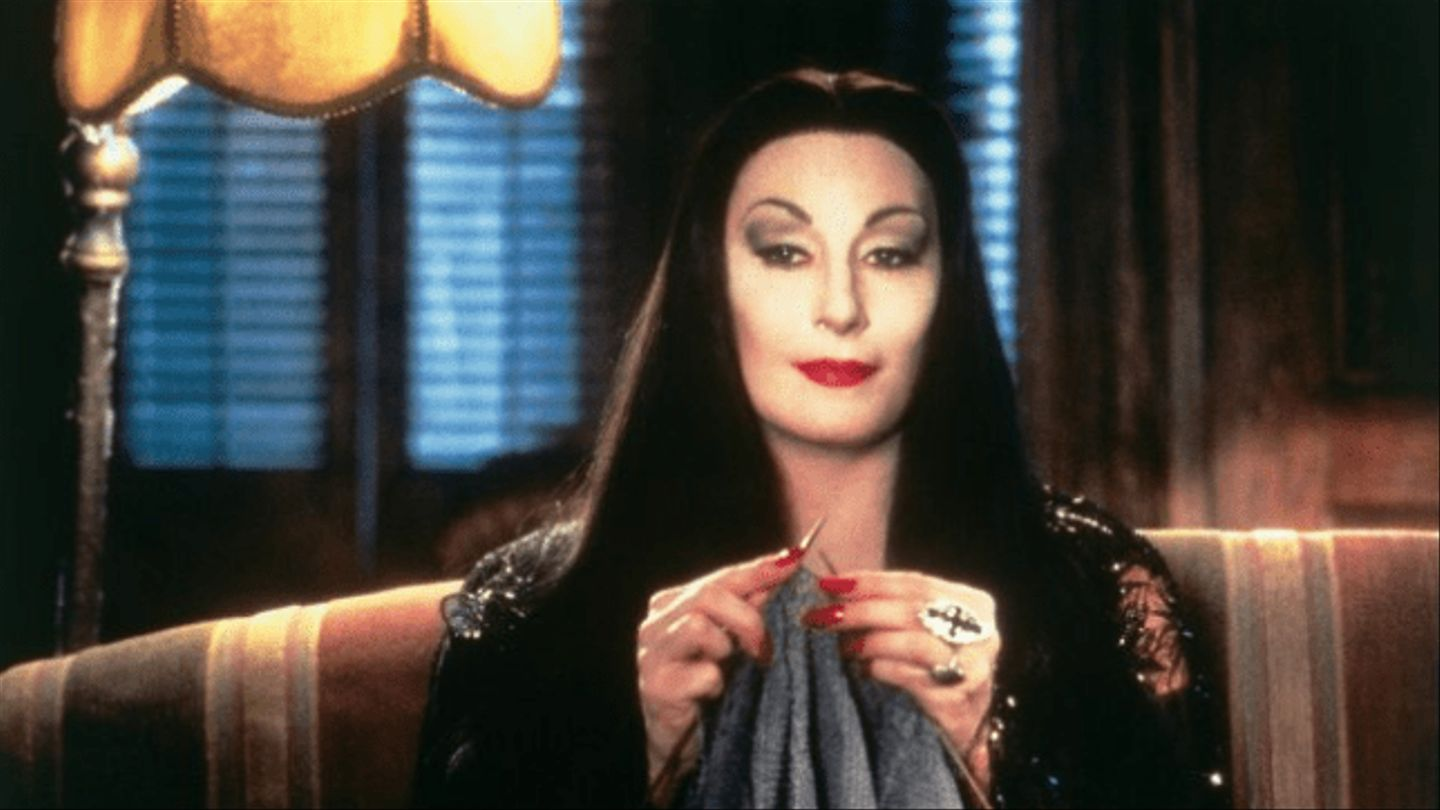 Can We Talk About...? Anjelica Huston's Iconically Campy Morticia Addams |  NewNowNext